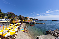 Italy, Liguria, Rapallo, Tourists on beach - AM001437