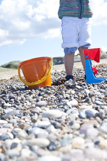 Denmark, Blavand, little girl playing on the beach, partial view - JFEF000239