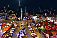 Turkey, Mugla Province, Marmaris, Restaurant and marina at night - SIE004839