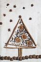Christmas tree shaped by cinnamon sticks, star anise, cloves, walnuts and dried orange slices - SBDF000353