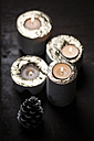 Four lighted advent candles and a fir cone - SBDF000348