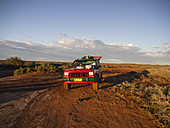 Australia, Western Australia, With the jeep in the outback - MBE000973