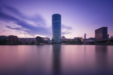 Germany, Hesse, Frankfurt, view to West Harbour at afterglow, long exposure - WAF000030