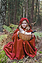 Little girl masquerade as Red Riding Hood sitting in the wood - CLPF000033