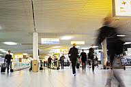 Netherlands, Amsterdam, Passengers at Schiphol Airport - BI000187
