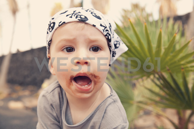 Spain, Lanzarote, Playa Blanca, little boy with headscarf covered with leftovers of chocolate - MFF000690