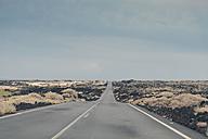 Spain, Lanzarote, view of road in between volcanic landscape - MFF000696