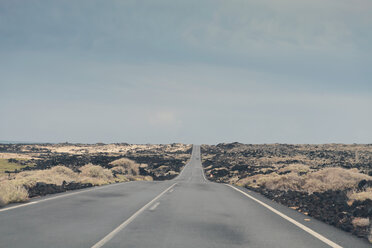 Spain, Lanzarote, view of road in between volcanic landscape - MFF000696