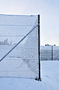 Germany, Thurinigia, Oberhof, Mesh wire fence in winter - BR000011