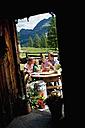 Austria, Salzburg State, Altenmarkt-Zauchensee, family having an alpine picnic - HHF004732