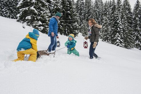 Austria, Salzburg Country, Altenmarkt-Zauchensee, Family walking in snow, pulling sledge - HHF004671