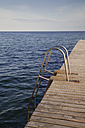 Germany, Schleswig-Holstein, Fehmarn, bathing jetty in front of horizon - WIF000238