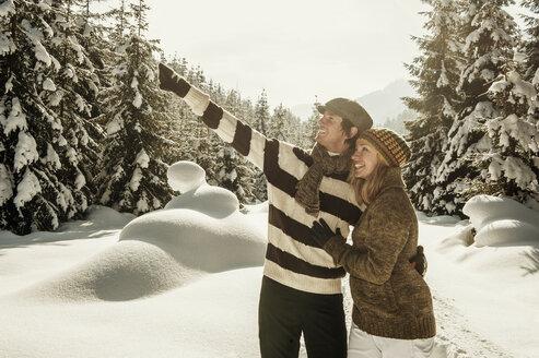 Austria, Salzburg State, Altenmarkt-Zauchensee, Smiling couple in winter landscape - HHF004688