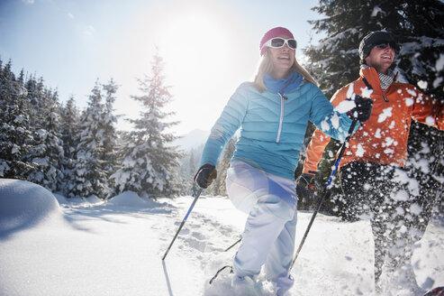 Austria, Salzburg State, Altenmarkt-Zauchensee, Couple snowshoeing in winter landscape - HHF004691