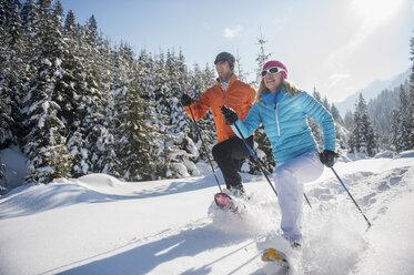 Austria, Salzburg State, Altenmarkt-Zauchensee, Couple snowshoeing in winter landscape - HHF004682