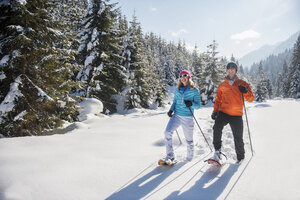 Austria, Salzburg State, Altenmarkt-Zauchensee, Couple snowshoeing in winter landscape - HHF004681