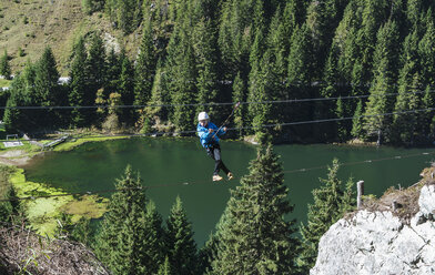 Austria, Salzburg State, Altenmarkt-Zauchensee, boy at via ferrata - HHF004702