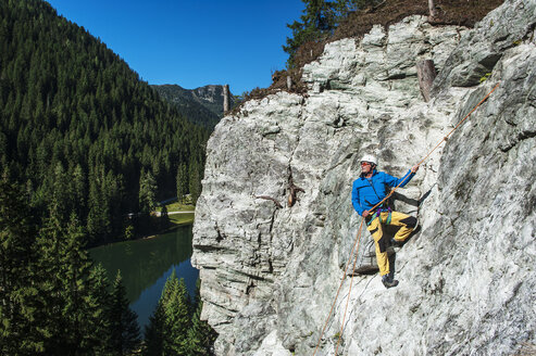 Austria, Salzburg State, Altenmarkt-Zauchensee, man at via ferrata - HHF004704