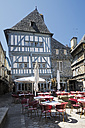 France, Bretagne, Dinan, Timber-framed houses and pavement restaurant - BI000199
