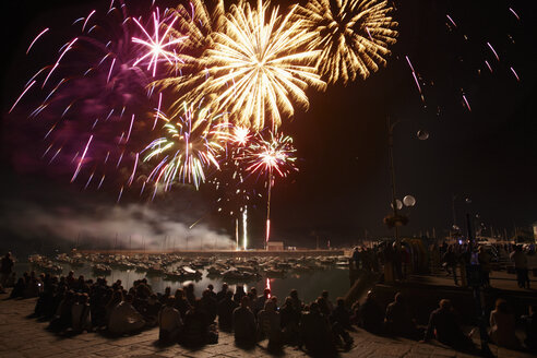 France, Bretagne, Bicnic, Fireworks at harbor on French national day - BI000264