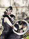 Portrait of young woman wearing Steampunk clothing, Victorian style - BSCF000403