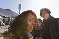 Germany, Bavaria, Munich, Three friends having fun at the Olympic Park, portrait - HSI000306