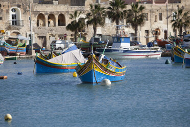 Malta, Marsaxlokk, Fishing boats in harbor - AM001572