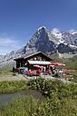 Switzerland, Bernese Oberland, Grindelwald, Alpine hut with tourists - WW002926