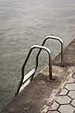 Croatia, Istria, Vrsar, handrail with steps at shore - KJF000285