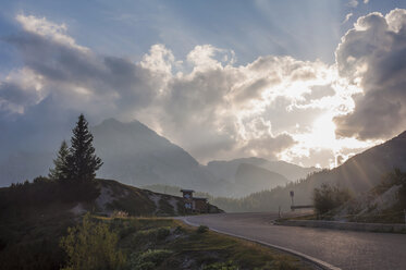 Italy, Dolomite Alps, road at evening twilight - MJ000494