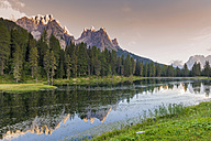 Italy, Dolomite Alps, mountains and lake by evening twilight - MJF000476