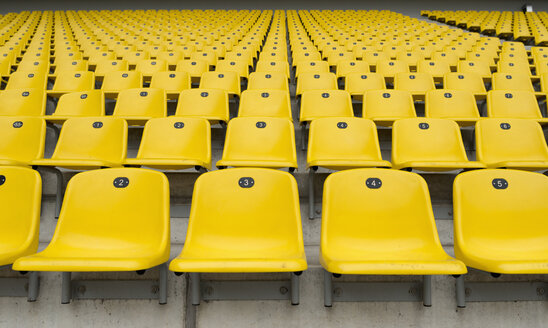Germany, North Rhine-Westphalia, Aachen, football stadium Tivoli, yellow seats, tribune - HL000330