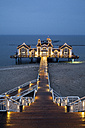 Germany, Mecklenburg-Western Pomerania, Rugia, view to lightened sea bridge at Baltic seaside resort Sellin at blue hour - WI000279