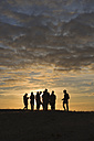 France, Bretagne, Finistere, Landeda, people during sunset near Plouguerneau - LA000460