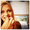 Young woman tasting unbaked dough - ABAF001142