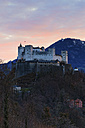 Austria, Salzburg State, Salzburg, View from Moenchsberg to Hohensalzburg Castle at sunset - GF000356