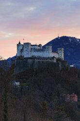 Austria, Salzburg State, Salzburg, View from Moenchsberg to Hohensalzburg Castle at sunset - GF000356