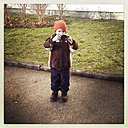 Three year old toddler with modern mirrorless camera, Germany, Berlin, m3 - ZMF000041