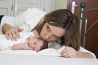 Mother kissing her newborn daughter - PA000202
