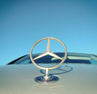 Mercedes Benz star on the bonnet in front of blue sky - ON000301