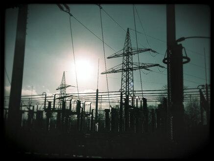 Power pole, substation at sunset, Germany, North Rhine-Westphalia, Minden - HOHF000310