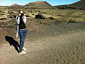 Photographer, photographed woman, Lanzarote Island, Canary Islands, Parque Nacional de Timanfaya, Spain - ONF000300