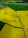 Wind mills, field of canola (Brassica rapa), aerial view, Mecklenburg, Germany - FBF000110