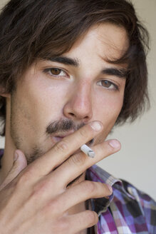 Portrait of smoking young man - WWF003164