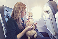 Mother with son in airplane - MF000718