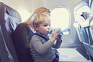 Mother with son in airplane - MF000721