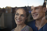 Smiling couple behind window - RBF001537