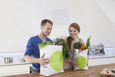 Couple holding shopping bags with purchases - RBF001580