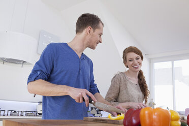 Young couple preparing food - RBF001584