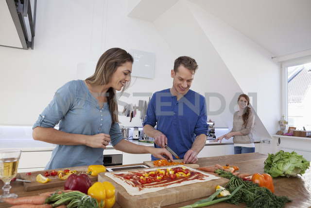 Three friends cooking together - RBF001586